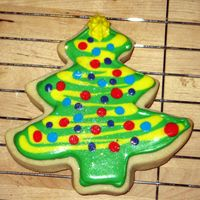 Christmas Tree Cookies  These are my first fancy decorated cookies! I used royal icing - thick for outlining and thinned for flooding. I piped on the details at a...