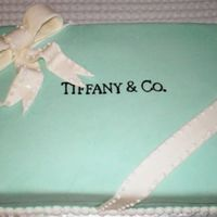Tiffany & Co. Cake White cake with Tiffany Blue Buttercream and Fondant. The cake bottom and top were made seperately and then placed on each other for the...