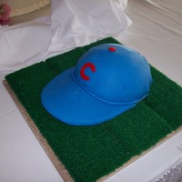 "Cubs Baseball Cap  Chocolate cake (I cut it horizontally and put buttercream between the ""layers"". Covered a foam sun visor with royal blue fondant..."