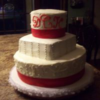 Red & Silver Wedding Cake This is a 3 tier, 1st tier is yellow cake, 2nd tier was strawberry and 3rd tier was white cake. I frosted the cake in cream cheese icing.