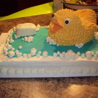 Rubber Duck Cake I made this cake for a couples son's first Birthday, The duck is made from chocolate cake that I carved out of 2 round cakes and the...