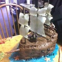 Pirates Of The Caribbean Cake is covered with MMF, each plank place individually (I covered with white then airbrushed brown, then rolled out brown MMF...). The...