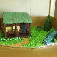 Old Cabin In The Woods  Guy at work wanted a cake for his wife's birthday, old cabin with a porch in the woods, but wanted cake to be the cabin. I said sure I...