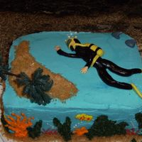 Scuba Diver  Birthday cake for a friend who is getting her diving certification. Scuba diver was easier than I thought it would be. Added the shark fins...