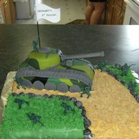 Army Tank  Cake for friends son, RKT tank, inside of cake was camo too. My friend sent me a picture of the design, don't know where she got it, I...