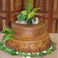 Wilburn_Groom.jpg chocolate buttercream, chocolate wafer border with ganache topping