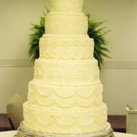 Wedding_Tower_0004.jpg I am very proud of this cake. It was all buttercream, each layer a different design. The bride gave me a photo from a bride magazine and it...