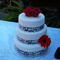 Demask Wedding Cake Red Velvet / cream Cheese frosting.. White fondant and Ribbon accent. Fresh flowers.