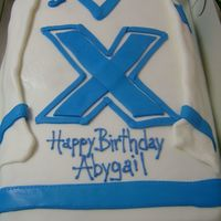 St. Fx Hockey Jersey! This cake was for a young lady who has accepted a hockey scholarship in Halifax, Canada!