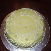 Lemon Birthday Cake   Lemon birthday cake with lemon filling. Flowers are MMF with silver dragees.