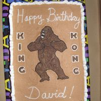 King Kong Cake  Cake made for a boy's birthday. Half side of cake is chocolate with chocolate fudge filling, other side is vanilla with strawberry...