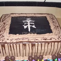 Jaguares Birthday Cake Symbol on cake is from my husband's favorite music group Jaguares. Dark chocolate cake with dark chocolate mousse filling and whipped...