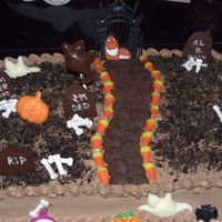 Fun Halloween Birthday Cake  Halloween birthday cake made for my son's birthday. The kids helped with this one! Crushed oreos was the dirt and we made freehand...