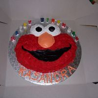"Elmo Birthday Cake I made this for my ""crazy about Elmo"" niece's 2nd birthday. I decided to frost it with a spatula instead of using stars. She..."