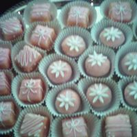 Pink Petit Fours I did these for a baby shower for a girl (thus the pink). Almond pound cake with almond buttercream filling and white choc./hint of almond...
