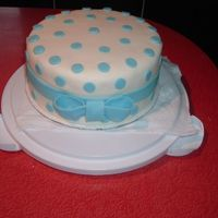 Baby Shower Cake The gal wanted baby blue dots a bit smaller that a quarter about an inch apart with a matching bow around the outside middle. The cake was...