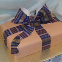 College Graduation Cake A college graduation cake with an afro-centric theme. The Kente cloth Bow is Gumpaste.