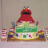 1St Birthday Elmo Cake I made this cake for my son's first birthday. Elmo is made from rice krispy treats, covered in buttercream, with fondant accents. I...