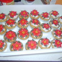 Poinsettia Cupcakes We had a final exam review in my college algebra class this week. I opened my big mouth and suggested a party... and got put in charge of...