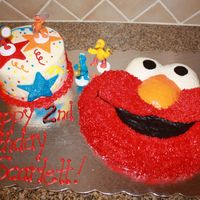 Elmo Cake Wilton pan used for elmo cake for my niece's 2nd birthday. She loves all sesame street, but elmo the most. Both cakes are WASC. Had to...