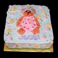 Feminine Bear Cake the bear created is similar to the bear belonged to the birthday girl