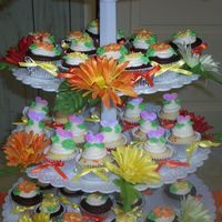 Gerber Cupcake Tree... yellow and orange gerber daisies with matching ribbon