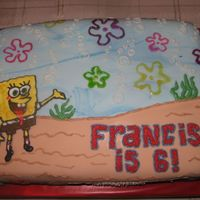 Sponge Bob fondant-covered chocolate cake decorated with royal icing, buttercream & piping gel