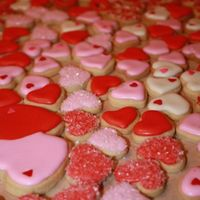 Valentine's Day Mini Cookies Some of the hundreds of mini (1inch) cookies I made for valentine's day. The cookies were bagged 4 of the small cookies and one big...