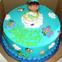 Dora The Explorer Buttercream icing with a plastic Dora