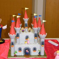 Mario Castle  My Pride & Joy!!!! 6 & 10 in square cakes. Once the cake was iced just to detail this cake took me 10 hours to finish! Cake is iced...