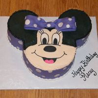 Minnie Mouse   I love making Minnie Mouse! 6 in rounds for ears with 9 in round head. B/c frosting with fondant accents