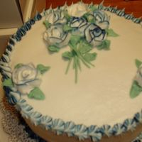 Rose Fancy This is just a simple 2 layer cake with dark blue/ white butter cream icing With a star border.This is just one of the cakes that I have...