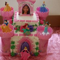 Princess Castle Disney Princess Castle cake. 11x15 German chocolate cake with BC and strawberry filling.