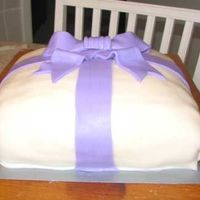 Birthdaycake As A Present Present for my sister. Covered with sugerpaste and the ribbon is mmf