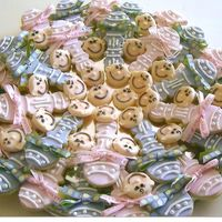 Baby Shower Cookies Another view of the rattle cookies and baby faces I made for my friend's daughter's baby shower. From the Flour Pot Cookie Book...
