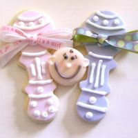 Baby Shower Cookies Made these for a friend's daughter's baby shower. Got the inspiration for the rattles from the Flower Pot Cookie Book, and the...