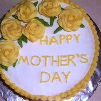 Mother's Day Cake Was having a hard time deciding how to decorate this so went with a VERY generic design. Yellow cake with buttercream frosting. Mom liked...