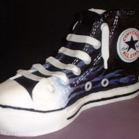 Converse Cake I made this for my daughter's 14th birthday. She wanted it painted the same as her new boots, so it is all hand painted fondant! The...