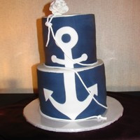"Tessa  3 layer cakes 8"" and 6"". Buttercream covered in navy blue fondant. White fondant anchor and gum paste rose. Rope is fabric trim..."