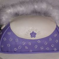 Purple Purse Cake  Birthday cake for niece. Vanilla bean cake with vanilla BC filling and MMF. Base is chocolate cake with vanilla BC. Handle is boa with wire...