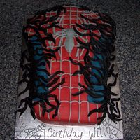 Spiderman Vs. Venom  Birthday cake. Carved bust of Spiderman with black representing Venom. Vanilla bean and chocolate marble cake with vanilla and chocolate BC...