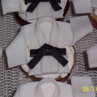 Karate Gi Cupcakes   Fondant Gi with black belt on vanilla and chocolate cupcakes with vanilla BC. Inspiration from other CC'ers and DD judo Gi.