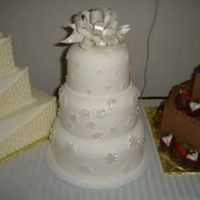 "Contour Pan Wedding Cake 6""8""10"" wedding cake using contour pans and gumpaste flowers and bow painted with pearl glaze."