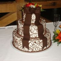 Chocolate Fondant Bow Wedding Cake This is still one of my favorite's! The bow was molded from chocolate fondant and assembled on site with the tails. The scrolls and...