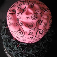 Do You See What I See? Practice cake covered in fondant; face is sculpted fondant underneath; gumpaste roses, scrolls done by hand with food color pen. tfl!