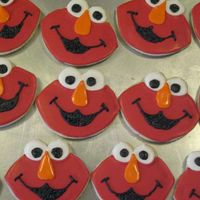 Elmo I made these for a dear friend. She will be taking them to her grandson's daycare. I made a template and hand cut the cookies. NFSC...