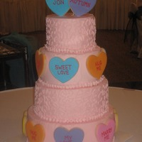 Valentine's Wedding Four tiers, 12, 10 8, and 6. Decorated with conversation heart cookies. The wedding had a Valentine's Day theme. Picture was taken...