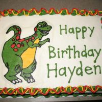 Dinosaur Cake Cake is iced in buttercream. Dinosaur is FBCT.