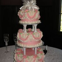 "Tamula's Wedding Cake 6-8-10"" rounds. The bride found a pic of this cake at Walmart and asked me to make it. It took a TON of buttercream frosting... dyed..."