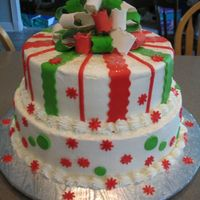 "Christmas Cake With Gumpaste Bow This cake is made of a 10"" and 12"" round, filled with strawberry. Buttercream icing with MMF decorations. My very first gumpaste..."